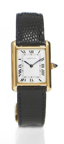 Cartier. An 18k gold rectangular wristwatch with 18k gold deployant buckleTank, 1980s
