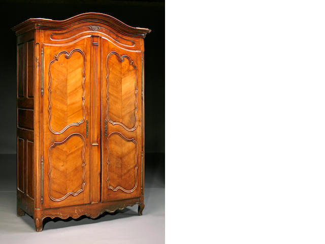 A Louis XV oak and fruitwood armoire