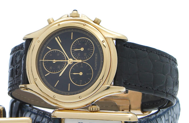 Cartier. An 18k gold quartz chronograph wristwatch with black dial Cougar, 1990s