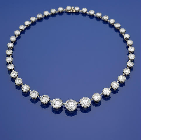 A diamond and platinum riviere necklace