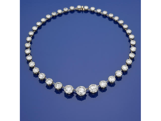 A diamond and platinum rivière necklace, French