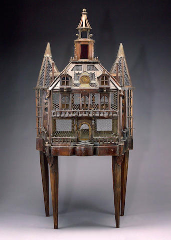 A Napoleon III beechwood, colored glass and brass mounted painted birdcage