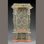 An Italian Rococo parcel gilt and polychrome decorated architectural niche