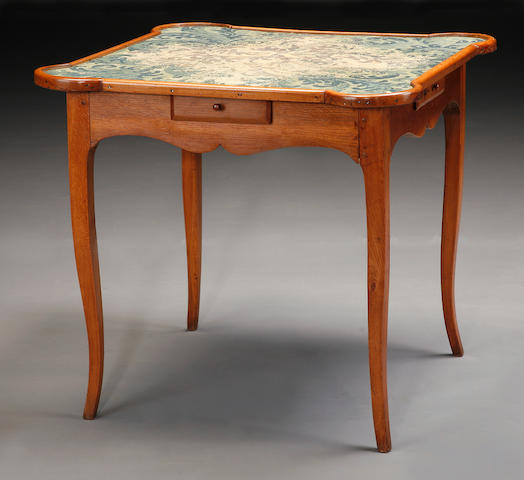 A Louis XV needlework mounted oak and walnut games table
