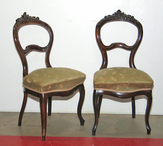 A set of six Rococo Revival mahogany side chairs, together with a table