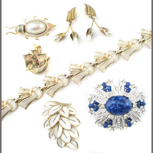 A collection of signed costume jewelry; featuring Trifari, Coro, Sarah Cov and other foreign marks