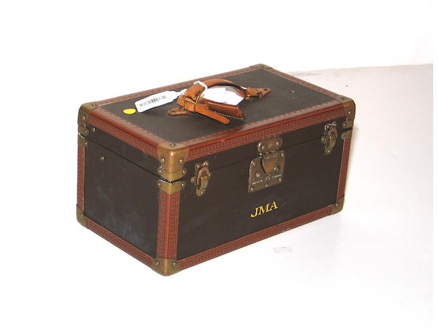A Louis Vuitton hardside suitcase