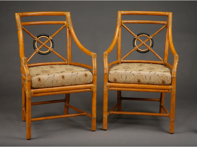 A set of six parcel gilt and parcel ebonized 'Rattan Target' dining chairs, comprising two armchairs and four side chairs