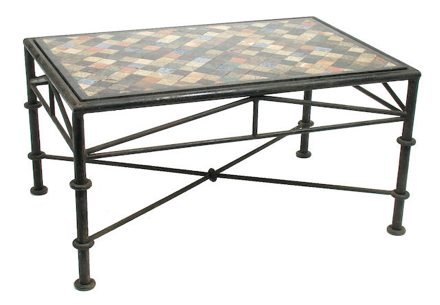 An inlaid marble and wrought metal low table