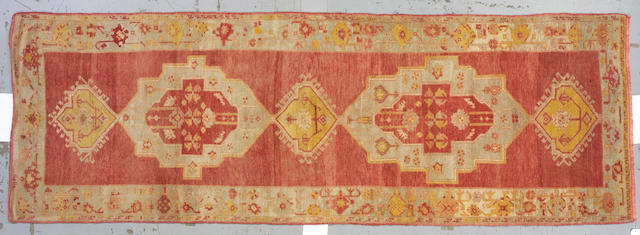 An Oushak runner West Anatolia, circa 1930 size approximately 4ft x 11ft 8in