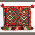 A Navajo Germantown saddle blanket, 2ft 10in x 2ft x 2in