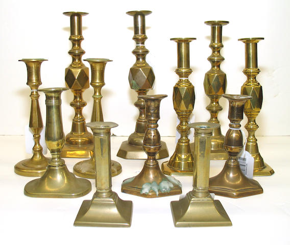 An assembled group of twelve English brass candlesticks, 19th century