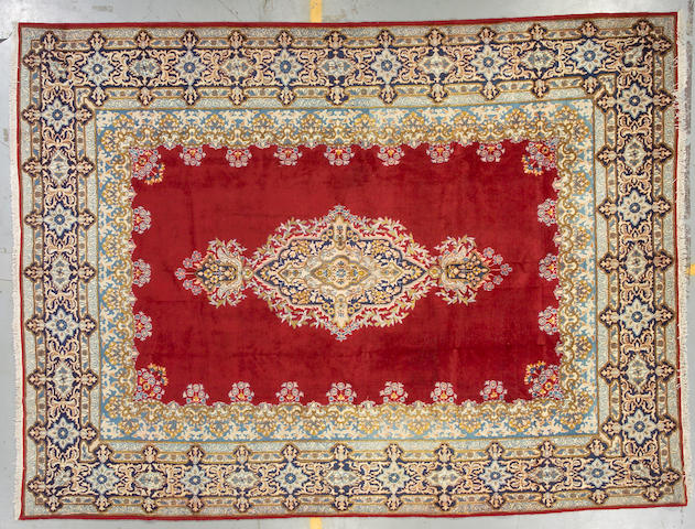 A Kerman carpet size approximately 9ft 1in x 12ft 1in