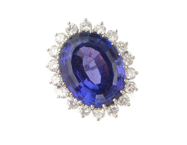 A tanzanite, diamond and fourteen karat white gold ring,