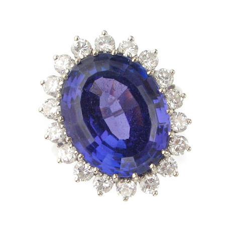 A tanzanite, diamond and fourteen karat white gold ring,