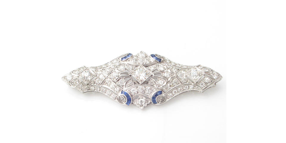 A diamond, sapphire and platinum brooch,
