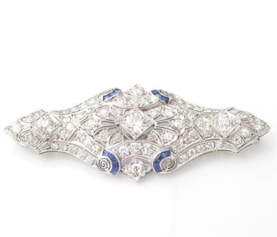 A diamond, sapphire and platinum brooch,