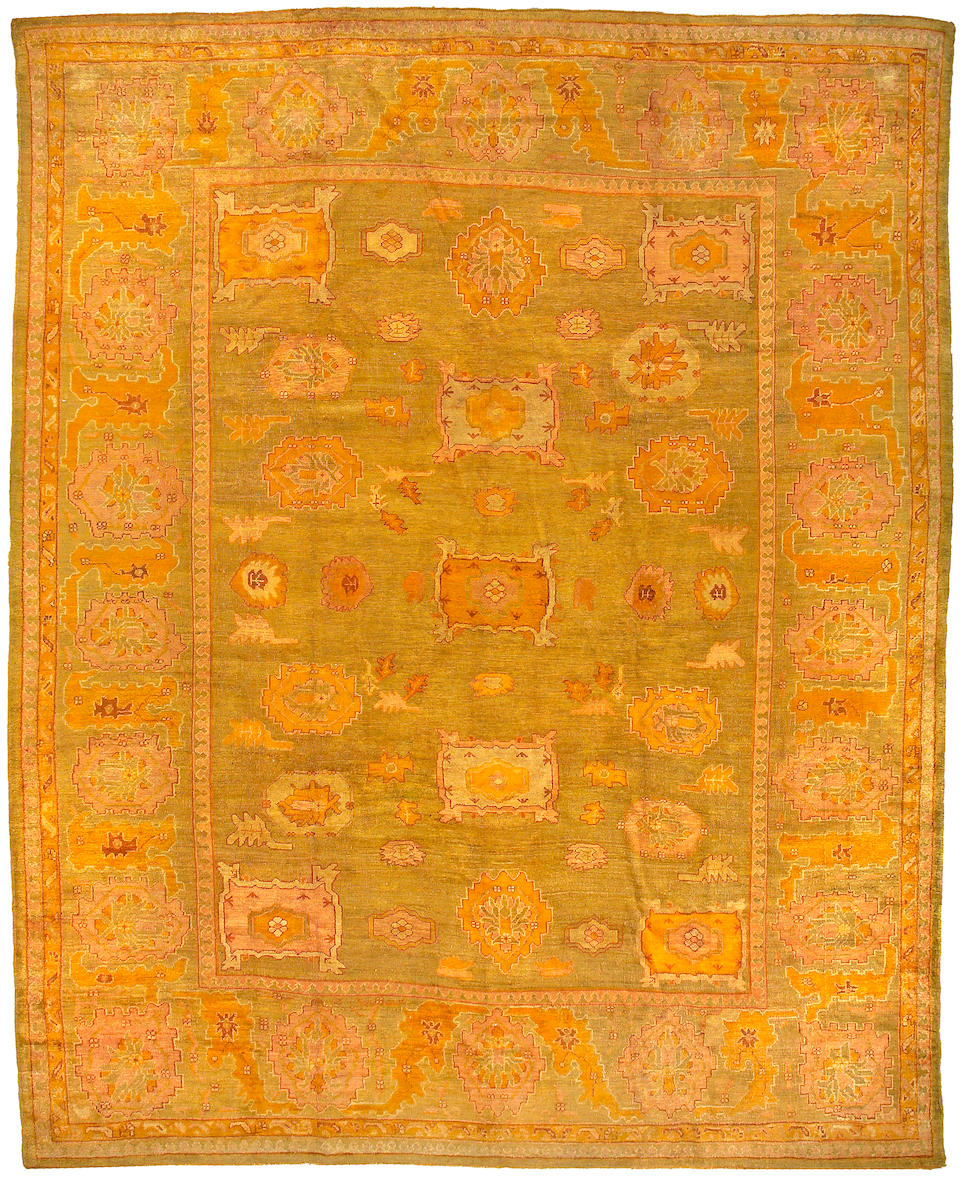 An Oushak carpet West Anatolia size approximately 12ft 8in x 15ft 6in
