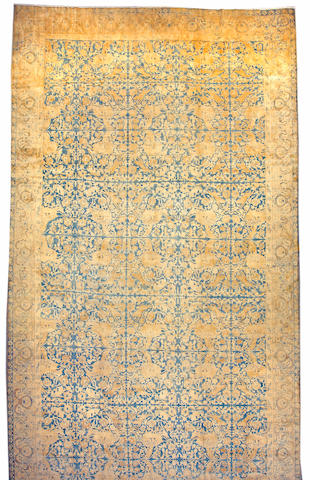 An Indian carpet size approximately 10ft 9in x 22ft 5in