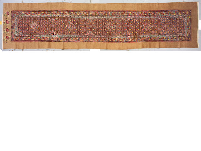 A Serab runner Northwest Persia size approximately 3ft 4in x 14ft 11in