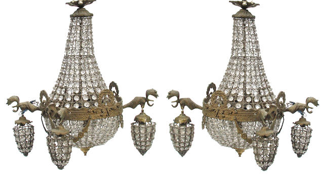A pair of glass and bronze deer head chandeliers
