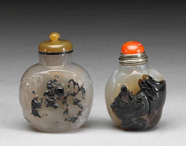 Two Suzhou agate snuff bottles with figure decoration
