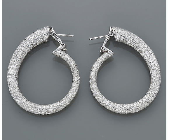 A pair of diamond and eighteen karat white gold spiral hoop earrings, Odelia