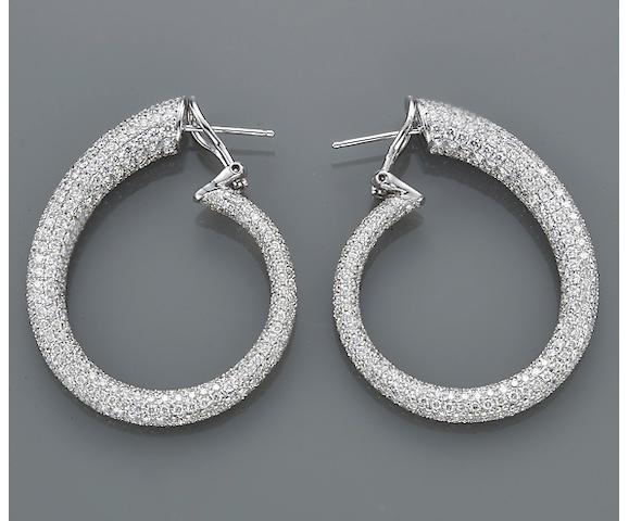 A pair of diamond and eighteen karat white gold spiral hoop earrings, Odelia