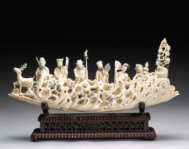A carved ivory tusk section depicting six immortals