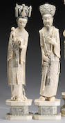 A pair of carved ivory figure of an emperor and empress