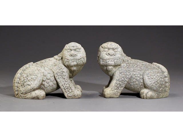 A pair of the carved granite lions