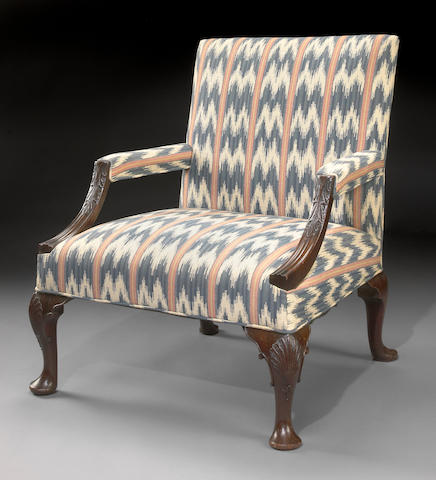 A George III carved mahogany library armchair