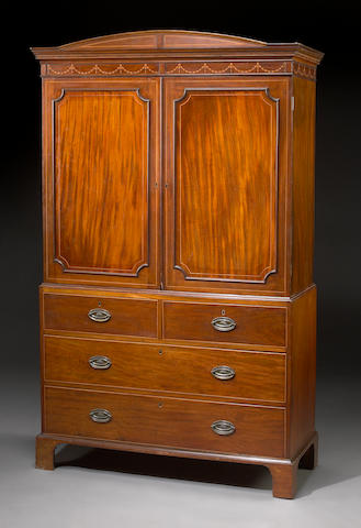 A Regency inlaid mahogany linen press
