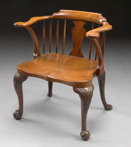 A George III carved mahogany Windsor armchair