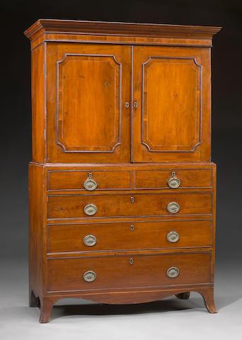 A diminutive Regency inlaid yew wood secretary linen press