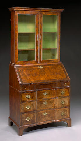 An inlaid walnut secretary bookcase