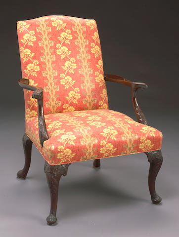 A George II style carved mahogany library armchair