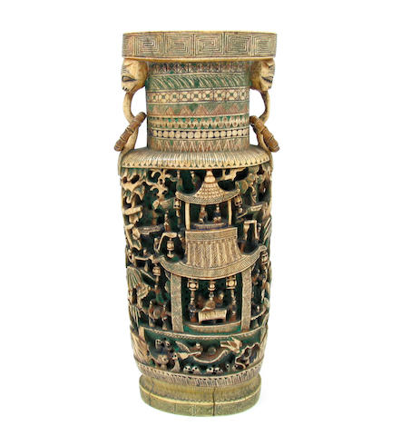 A Chinese carved ivory and polychrome decorated vase