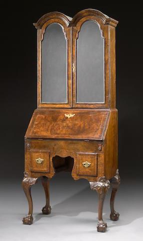 A Queen Anne style walnut secretary cabinet