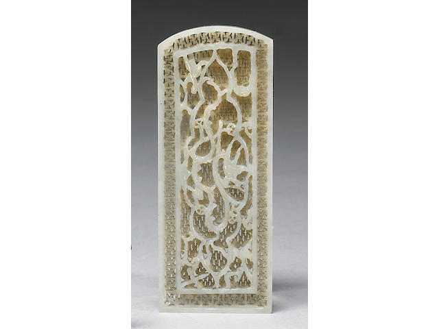 A pale celadon nephrite reticulated belt plaque Late Ming Dynasty