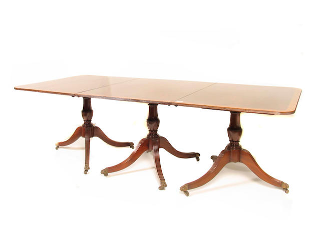A Regency style three pedestal dining table