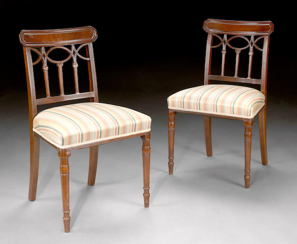 A set of seven George III mahogany dining chairs