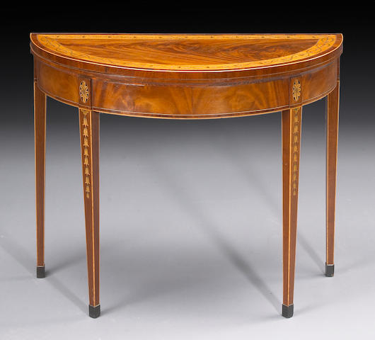 A George III crossbanded mahogany games table