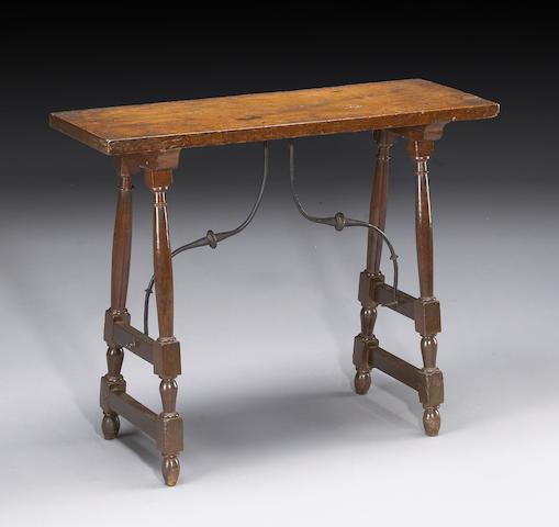 A Spanish Baroque iron mounted walnut table
