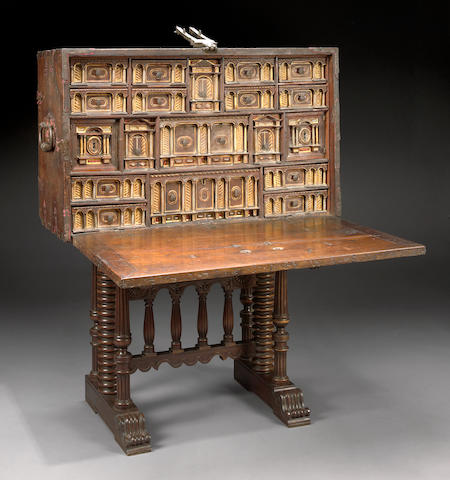 A Spanish Baroque walnut vargueno on stand