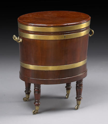 A George III brass bound mahogany cellarette on stand