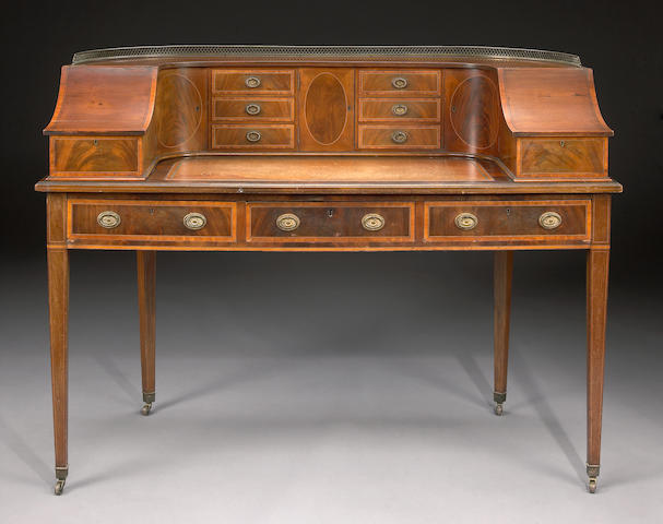 A George III style inlaid mahogany Carlton House desk