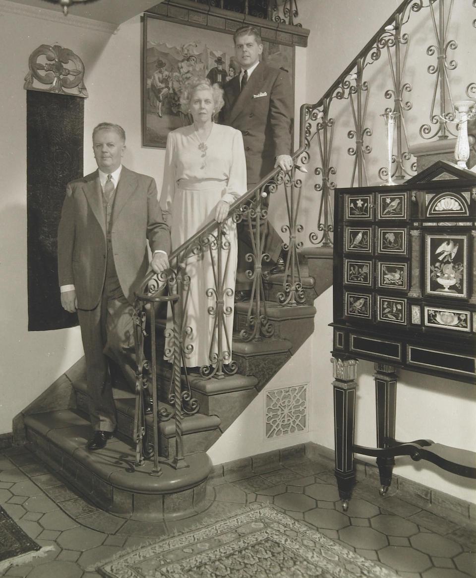 An impressive Italian ebonized and pietra dura mounted table cabinet