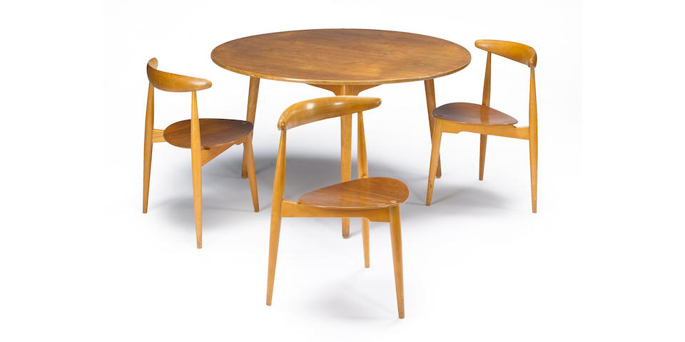 A Hans Wegner teak and plywood dining suite, comprising a table and three 'Heart' chairs