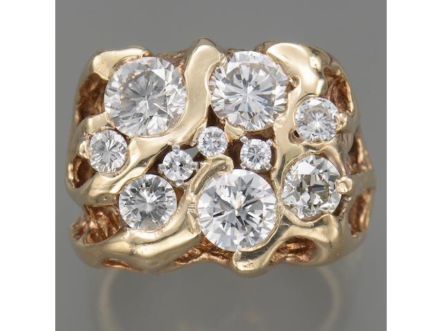 A diamond and fourteen karat gold gent's ring